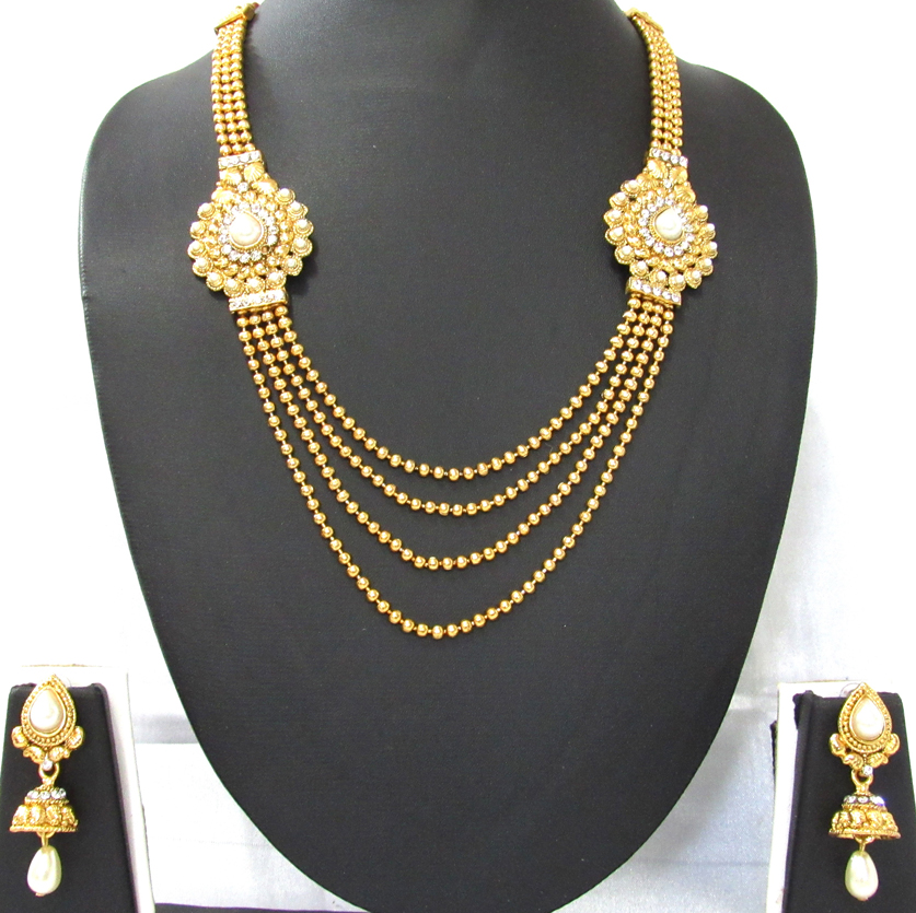Golden 4 Line Tilak Pearl Stone Necklace Set