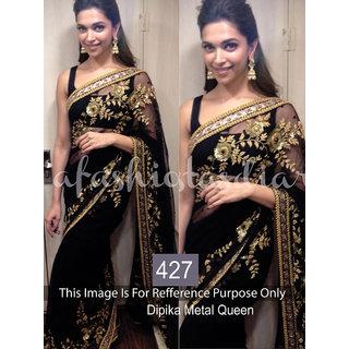 Deepika Black net saree with golden zari thread work