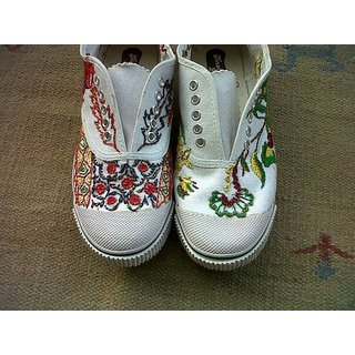 Hand Embroidery With Art Silk On Canvas Shoes.