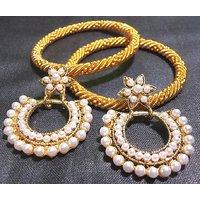 Golden jali bangles with flower polki