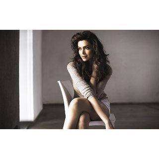 Deepika Padukon sitting on chair Poster