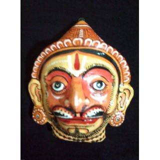 A pattachitra painting handcrafted papier mache mask of lord hanuman a mythological character.