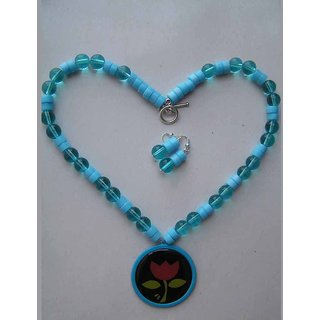 Necklace With Two Varieties Of Blue Beads Highlighted With A Cool Enamel Pendant