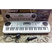Toy Vala ELECTRONIC KEYBOARD 54 KEYS MUSICAL PIANO WITH MICROPHONE BANDSTAND 5407