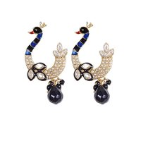 Rajwada Arts Fancy Peacock Earrings With Black Stone