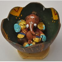 Ganesha Clay Idol In Coconut Shell