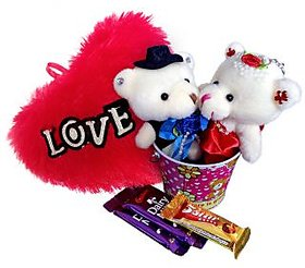 Valentine Loving Couple Together with a Heart & Chocolates