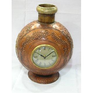 Clock in iron pot