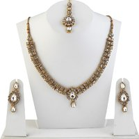 Kriaa Austrian Stone Gold Finish Necklace Sets With Maang Tikka