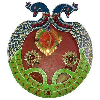 Peacock Design Puja Thali  A Flaming Diya