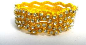 yellow color Metal and stone shining Kundan Bangle set