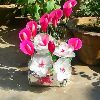 Artificial pink and white flower