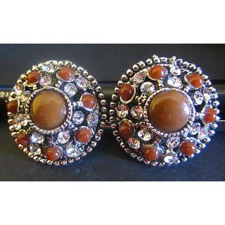 round brown earrings with stones.