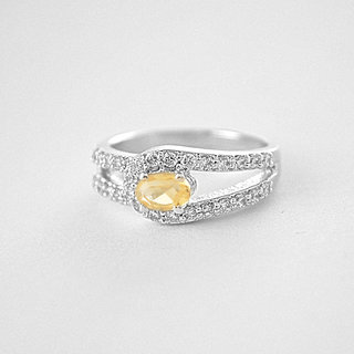 Silver zircon ring with golden topaz stone to be touched by nature, is to infuse the spirit with life.
