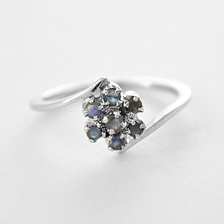 Silver with semi-precious Blue Sapphire to be touched by nature, is to infuse the spirit with life.