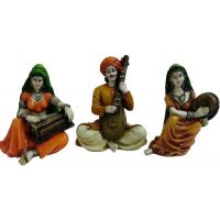 Rajasthan A Man And Two Women Playing Music Showpiece - 15.24 Cm(polyresin, Multicolor)