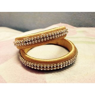 gold colored tread bangles with stones