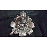Lord Ganesha Sitting On A Flower