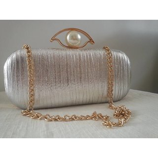 silver brass clutch with string in metal