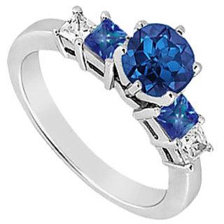 Ravishing Sapphire And Cubic Zirconia Three Stone Engagement Ring 14K White Gold