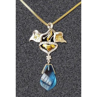 beautiful diamond studded pendant set in gold and silver