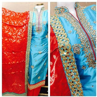 AMAZING OUTFIT Presents Desiner silk dupatta suits in Firozi and Red color