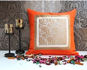 ANS Orange cushion with offwhite and gold jacquard sq patch