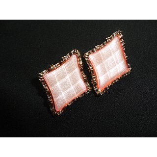 Diamond shaped stud with 3D effect..