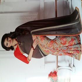 Nuteez Brown Georgette Printed Saree With Blouse