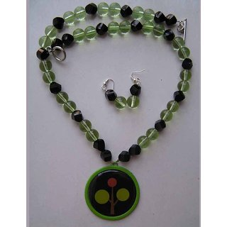 Necklace With Green And Black Glass Beads Highlighted With A Cool Enamel Pendant