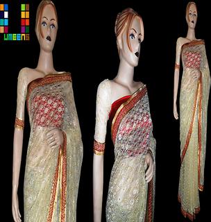 golen self  net saree with satin blouse