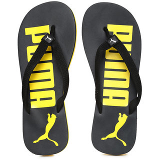 5e4c82d46e248f Buy PUMA Men Black Yellow Printed Flip-Flops Online - Get 69% Off