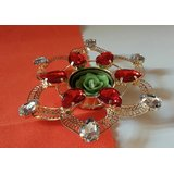 Flower Shape Golden Diya With Orange Stone Studded And Candle