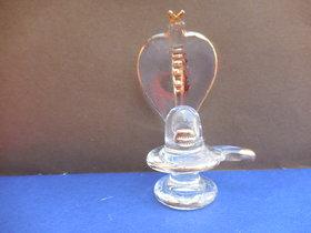 golden polished shivling in glass handicraft