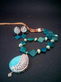 Ad. Designer pendent set adored with quartz