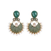 Rajwada Arts Green Stone Studded Pearl Earring
