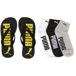 605f548444227 Buy Puma Men Black Yellow Printed Flip-Flops   Socks Combo Online ...