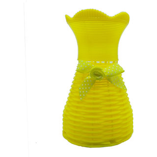 Flower vases by Random  flower vases for living room home decor  flower pots  yellow vase with a bow in front