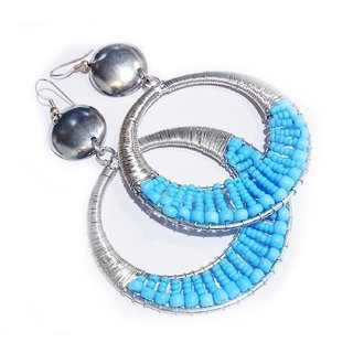 These Bali style synthetic turquoise hoop earrings for women have beaded detail that give our sterling silver hoops an e