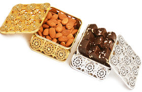 Ghasitaram Gifts  Silver and Gold Almonds and Chewy Choco Fudge Boxes