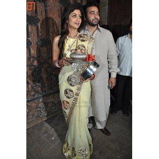 Palash fashion's cream Color embroidered georgette Fancy Designer Saree