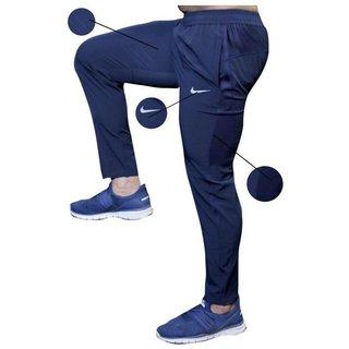 Obligar tinción viudo  Buy Nike Blue Polyester Track pants for Men Online - Get 82% Off